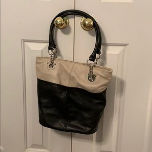 Black and cream shoulder bag.
